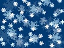 Fiocchi di neve di caduta, piccolo e grande su un fondo blu Immagine Stock Libera da Diritti