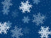 Fiocchi di neve di caduta, piccolo e grande su un fondo blu Fotografie Stock Libere da Diritti