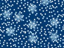 Fiocchi di neve di caduta, piccolo e grande su un fondo blu Immagini Stock