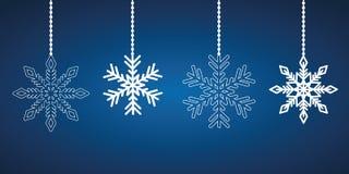 Fiocchi di neve d'attaccatura bianchi su un fondo blu illustrazione di stock