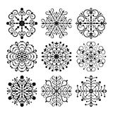 Fiocchi di neve decorativi di vettore impostati Fotografie Stock
