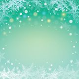 Fiocchi di neve di Natale su fondo verde Immagine Stock