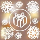 Fiocchi di neve e contenitore di regalo su fondo vago illustrazione vettoriale
