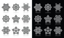 Fiocchi di neve, icone in bianco e nero di inverno messe Fotografia Stock