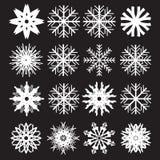Fiocchi di neve messi su fondo nero Immagini Stock