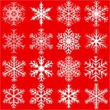 Fiocchi di neve su colore rosso Fotografia Stock Libera da Diritti