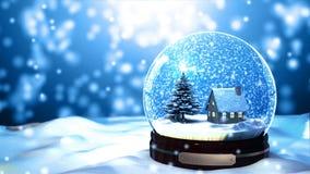 Fiocco di neve del globo della neve di Natale con le precipitazioni nevose su fondo blu immagini stock