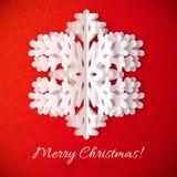 Fiocco di neve del Libro Bianco su fondo decorato rosso Fotografia Stock