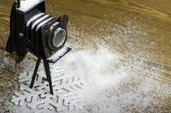 Fiocco di neve e macchina fotografica di Natale Immagine Stock
