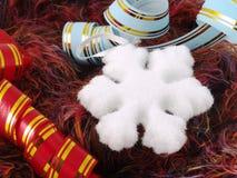 Fiocco di neve e nastro di natale Fotografie Stock