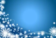 Fiocco di neve e priorità bassa dell'azzurro degli indicatori luminosi Fotografia Stock Libera da Diritti