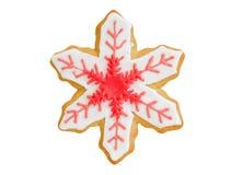 Fiocco di neve rosso del biscotto di Natale su bianco Immagini Stock Libere da Diritti