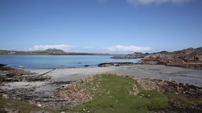 Fionnphort port Isle of Mull Scotland UK view to Iona island pan stock footage