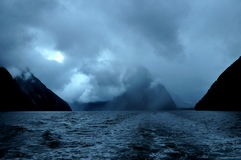 Fiord Milford Sound at sunset and with clouds, South Island, New Zealand Stock Image