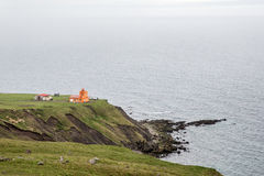 Fiordi rossi Islanda del nord, orario invernale del faro Fotografie Stock Libere da Diritti