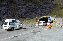 Fiordland - Homer Tunnel. FIORDLAND,NZ - JAN 14:Campers enters Homer Tunnel on Jan 14 2014.It's a 1.2km (0.75 miles) road tunnel and until it was sealed and Royalty Free Stock Photo