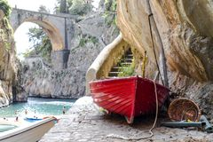 Fiordo di Furore beach. Furore Fjord Amalfi Coast Positano Naples Italy. Fishermen colored boats on the beach, under the bridge of the fjord. The turquoise royalty free stock photos