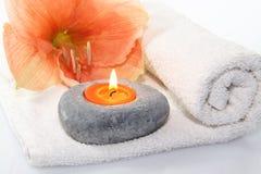 Fiore con la candela Immagine Stock