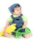 Fiore della holding della neonata Fotografie Stock Libere da Diritti