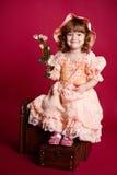 Fiore di rosa della holding della bambina Fotografia Stock Libera da Diritti