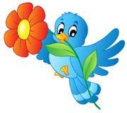 Fiore di trasporto dell'uccello blu Fotografie Stock Libere da Diritti
