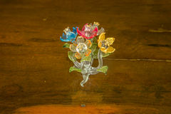 Fiore di vetro su legno Immagini Stock