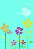Fiore e annaffiatoio Fotografia Stock