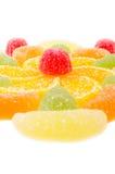 Fiore fatto dai pezzi di marmellata d'arance isolati Immagine Stock Libera da Diritti