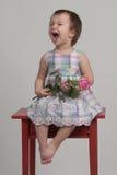 Fiore gridante della holding del bambino Fotografia Stock Libera da Diritti