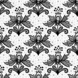 Fiore nero del pizzo isolato su fondo bianco Fotografia Stock