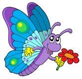 Fiore sveglio della holding della farfalla Fotografia Stock Libera da Diritti