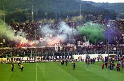 Fiorentina smokes. Fiorentina fans in action with smoke candles in the italian football match fiorentina vs milan Royalty Free Stock Image
