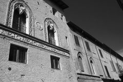 Fiorenzuola d`Arda Piacenza, old buildings. Fiorenzuola d`Arda Piacenza, Emilia Romagna, Italy: historic buildings. Black and white Stock Photo