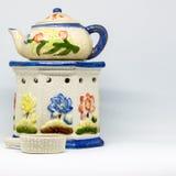 Fiori e ceramico Fotografie Stock