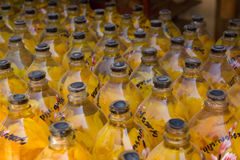 Fiori gialli in bottiglie Immagine Stock Libera da Diritti