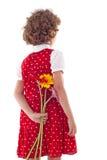 Fiori nascondentesi della ragazza per il giorno della madre Fotografie Stock
