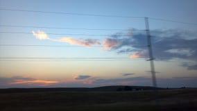 Fios de telefone na frente das nuvens de incandescência Foto de Stock Royalty Free