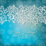 Fir border. Hand -drawn fir branches cowered with frost and forming border over blue background with snowflakes Stock Image