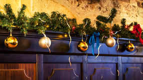 Fir branch and balls decorate wall Royalty Free Stock Photo