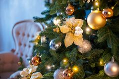 Fir branch with balls and festive lights on the Christmas background with sparkles. stock photo