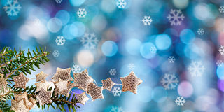 Fir branch and blurred Christmas lights Royalty Free Stock Photos