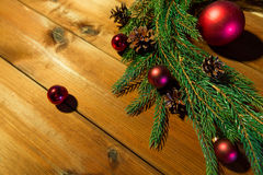 Fir branch with christmas ball and pinecones Royalty Free Stock Photos