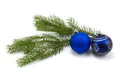 Fir branch with christmas baubles Royalty Free Stock Photo