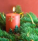 Fir branch and christmas candle Stock Images