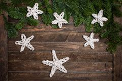 Fir branch with Christmas decorations handmade paper stars on ru Stock Photography