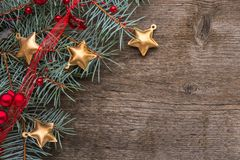 Fir branch with Christmas decorations on old wooden background with empty space for text. Top view royalty free stock images
