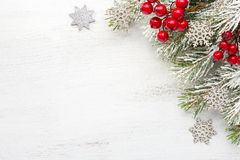 Fir branch with Christmas decorations on old wooden shabby background with empty space for text. Top view
