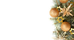 Fir branch with Christmas decorations    on white background. Fir branch with Christmas decorations  on white background Stock Photography