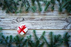 Fir branch christmas and gift on white wood stock image