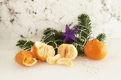 Fir branch with clementine and stars Stock Photography